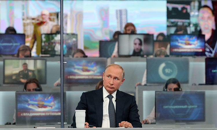 Russian President Vladimir Putin holds his annual televised phone-in with the nation in Moscow on June 7, 2018. Russian journalist Viktor Korb was charged on May 16 by authorities in the town of Omsk, in southwestern Siberia, with terrorism-related offenses. (AFP/Mikhail Klimentyev/Sputnik)