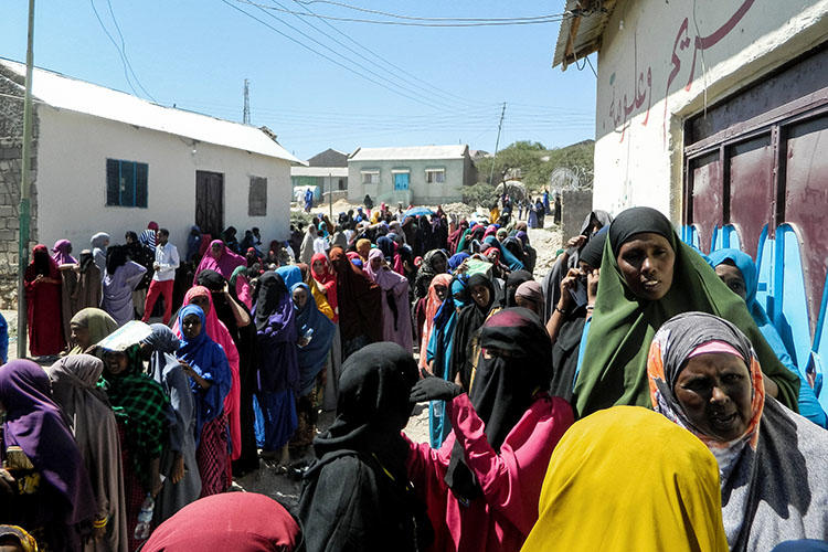 People wait in a line to cast their votes in the presidential election at a polling station in Hargeisa, Somaliland, on November 13, 2017. Somaliland authorities in late May 2018 detained two journalists and banned two TV stations. (AFP)