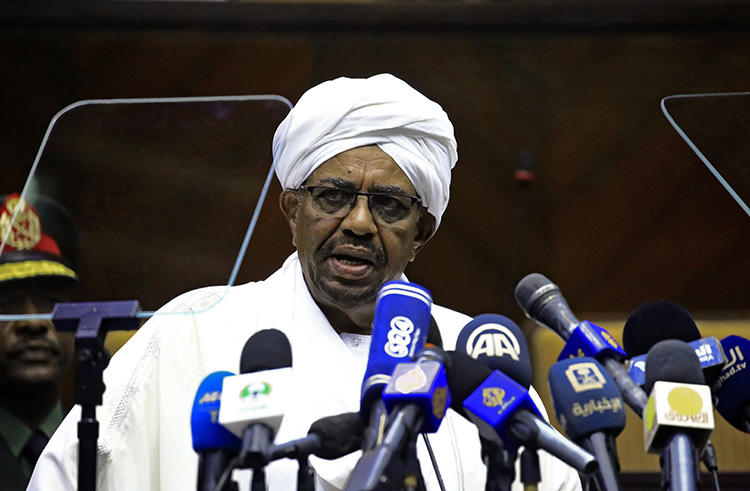 Sudan's President Omar Al-Bashir speaks to parliament in the capital, Khartoum, in April. Sudanese authorities are harassing the critical press by censoring news outlets and questioning journalists. (AFP/Ashraf Shazly)