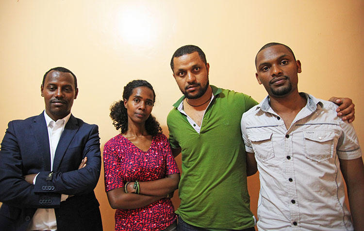 Ethiopian photojournalist Aziza Mohamed, pictured in Nairobi in 2014 with her colleagues, from left, Endalkachew Tesfaye and Endale Teshi, who both now live in the U.S. and Habtamu Seyoum, who is still waiting for resettlement. (CPJ/Nicole Schilit)