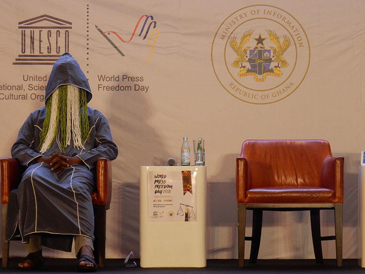 Ghanaian investigative journalist Anas Aremeyaw Anas participates in disguise on a panel at the UNESCO World Press Freedom Day event in Accra, Ghana, on May 3, 2018. One month later, Ghanaian member of parliament, Kennedy Agyapong, has been threatening Anas and those perceived as close to his undercover investigative film about corruption and football in Ghana. (CPJ/Jonathan Rozen)