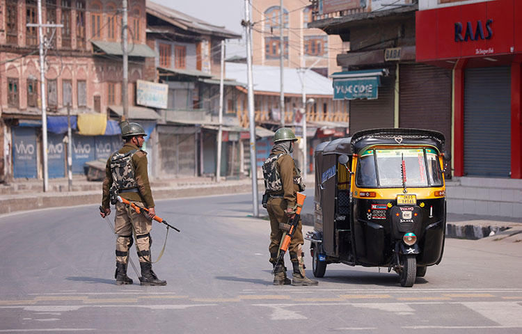 Indian police stop an auto-rickshaw in the city of Srinagar in Jammu and Kashmir state in April 2018. Officers from the Central Reserve Police Force, a paramilitary group, on June 2 beat journalist Muheet ul Islam while he was on his way to cover the funeral of a civilian who was allegedly crushed to death by a CRPF vehicle the previous day in the state's Srinagar city, according to Islam and news reports. (Reuters/Danish Ismail)