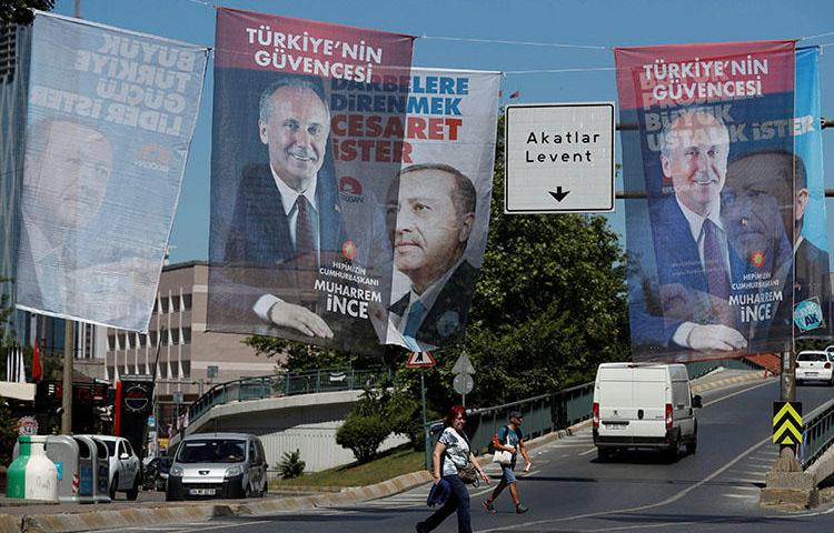 Campaign posters for Turkey's elections are seen in Istanbul in June 2018. The press crackdown continues, with more journalists arrested or charged for reporting critically. (Reuters/Osman Orsal)