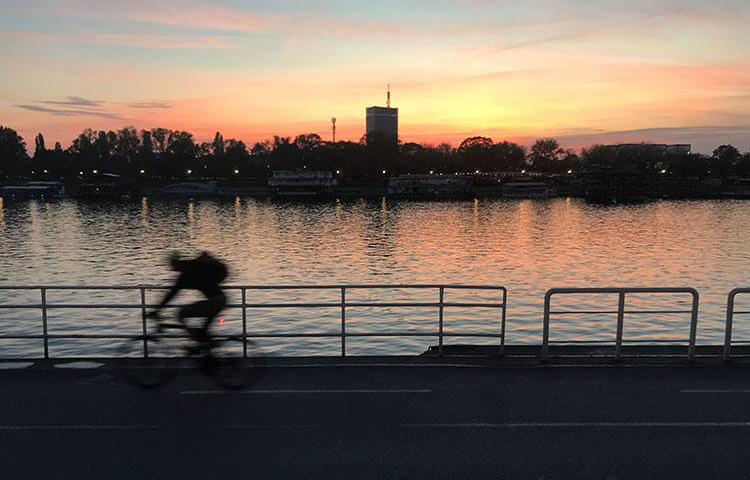 A cyclist rides on the bank of Sava river in Belgrade, Serbia, on October 21, 2017. A journalist who had been reported missing was found unharmed on June 15, 2018. (Reuters/Radu Sigheti)