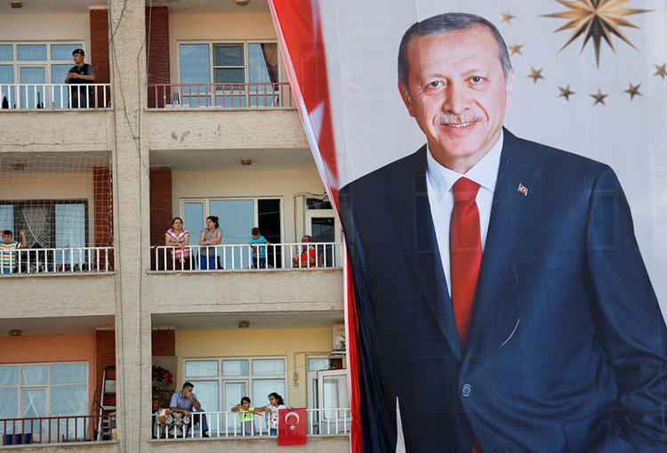 People watch an election rally for President Erdoğan in Mardin, on June 20. An OSCE report released ahead of Turkey's elections highlights the restrictive environment for the press. (Reuters/Goran Tomasevic)