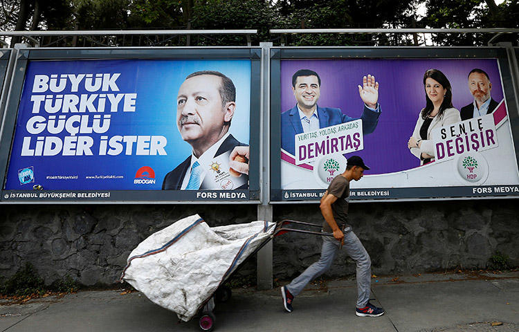 Election posters for President Recep Tayyip Erdoğan, left, and Turkey's main pro-Kurdish Peoples' Democratic Party, in Istanbul in June. CPJ joins other organizations in calling on presidential candidates to address press freedom issues. (Reuters/Huseyin Aldemir)