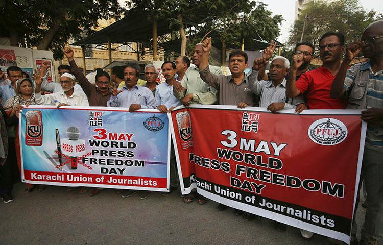 Pakistani journalists rally on Press Freedom Day in Karachi, Pakistan, on May 3, 2018. Two journalists were attacked June 5 in the city of Lahore. (AP Photo/Fareed Khan)