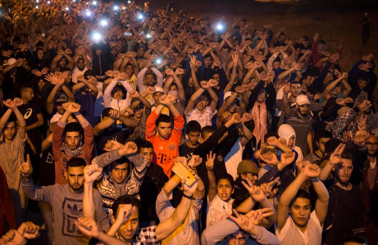Protesters chant during a demonstration in the northern Moroccan town of Imzouren on June 11, 2017. A Moroccan court sentenced two journalists to prison in late June 2018. (AFP/Fadel Senna)