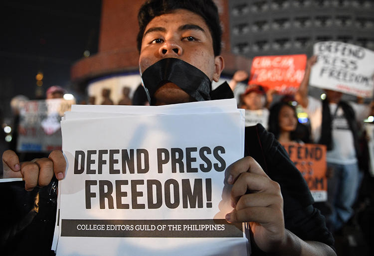 A rally calling for greater press freedom in Manila in January 2018. Philippine journalists say President Rodrigo Duterte is trying to intimidate the media. (AFP/Ted Aljibe)
