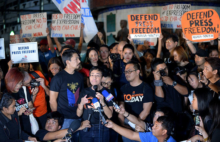 Rappler founder and CPJ's 2018 Gwen Ifill Press Freedom awardee Maria Ressa, pictured at a press freedom protest in January. Rappler is a prime target of the president's media intimidation tactics. (AFP/Ted Aljibe)