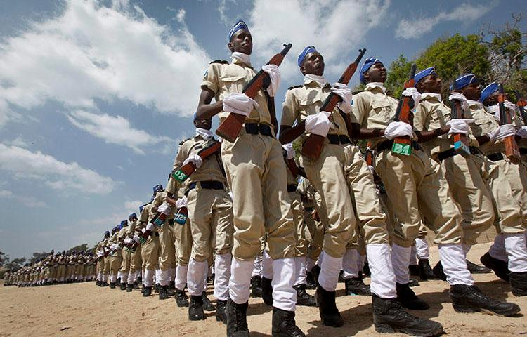 Somali police at a ceremony in Mogadishu on December 20, 2017, to mark the 74th anniversary of the formation of the police force. Abdirizak Kasim Iman, a cameraperson for the privately owned SBS TV, was shot dead in Mogadishu on the afternoon of July 26, 2018, according to news reports. (AP/Farah Abdi Warsameh)