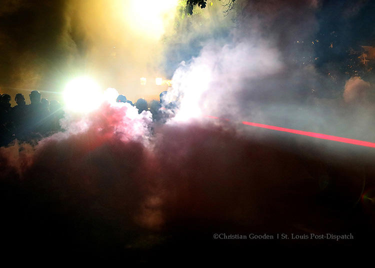 Police use laser-sighting while removing a large group of protesters in St. Louis on September 15, 2017. Journalist groups say news outlets and police need better training to ensure the press can cover protests safely. (Christian Gooden/St. Louis Post-Dispatch)