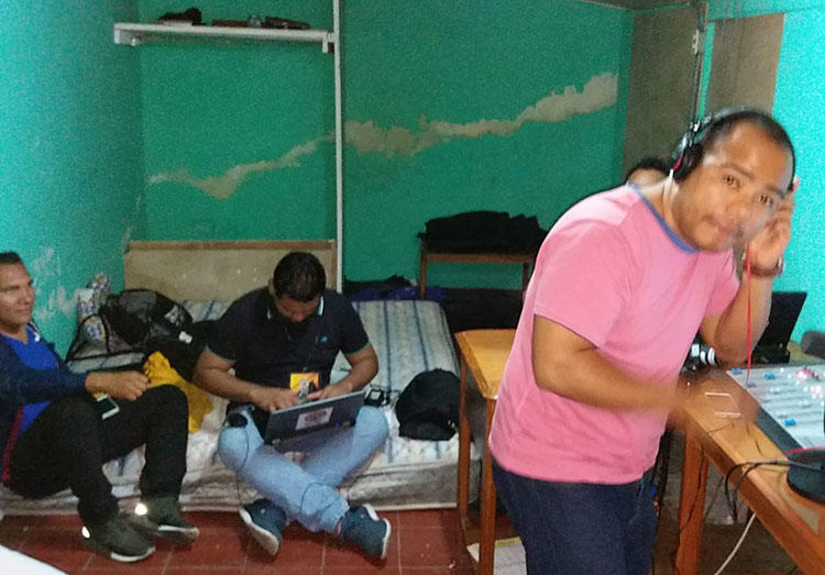 Radio Darío staff in their temporary studio. Arsonists set fire to the station's headquarters in April. (Shannon O'Reilly)