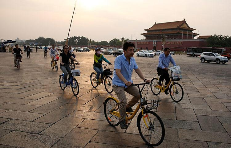 Cyclists cross Tiananmen Square in Beijing, China on June 16, 2017. A Sichuan province court on July 13, 2018, sentenced Chinese freelance political cartoonist Jiang Yefei to prison for six years and six months on charges of