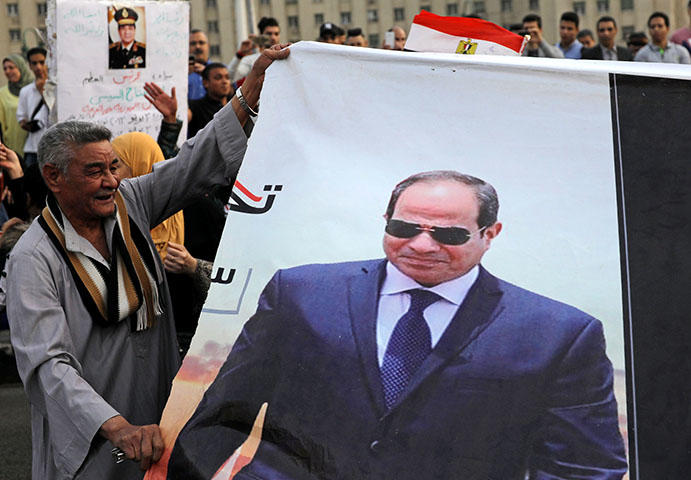 Supporters of Egyptian President Abdel Fattah el-Sisi in Tahrir square in April 2018 after the results of the country's recent presidential elections were announced. The country's authorities have continued to clampdown on the press using false news charges after the elections, according to reports. (Reuters/ Mohamed Abd El Ghany)