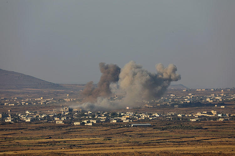 Smoke rises from the Quneitra area in southwestern Syria on July 16, 2018. Sama TV reporter Mustafa Salamah was covering the Syrian army's attempt to retake the area when he was fatally injured by a shell, according to reports. (Reuters/ Alaa al Faqir)