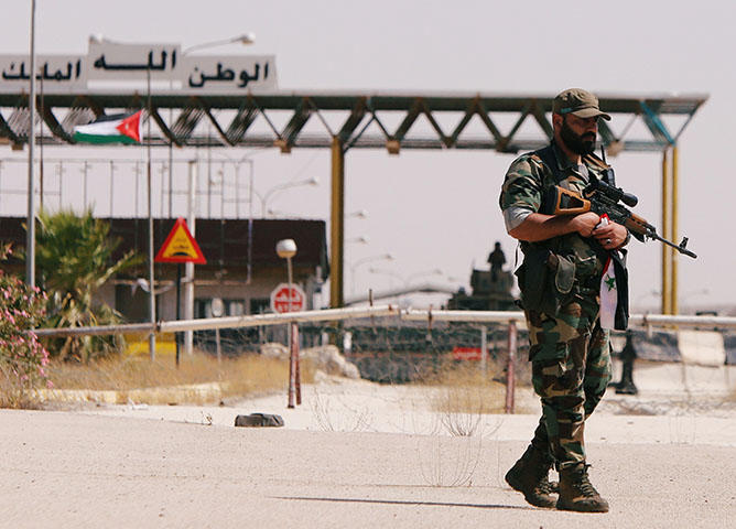 A Syrian soldier at the Nasib border crossing with Jordan in Deraa, Syria on July 7, 2018. At least 70 journalists and media workers are caught in Quneitra between advancing forces aligned with Syrian President Bashar al-Assad and the closed borders of Israel and Jordan, according to CPJ research. (Reuters/ Omar Sanadiki)