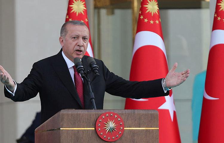 Turkish President Tayyip Erdogan speaks during a ceremony at the Presidential Palace in Ankara, Turkey on July 9, 2018. Turkey's National Security Council, chaired by President Recep Tayyip Erdoğan, on July 8 shuttered three newspapers under a new decree passed the same day, according to reports. (Reuters/Umit Bekta)