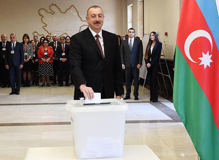 Azerbaijani President Ilham Aliyev casts his vote during the presidential election in Baku, Azerbaijan, on April 11, 2018. Azerbaijani journalist Afgan Sadygov was sentenced to 30 days in jail on July 7. (AZERTAC/Vugar Amrullayev/Pool via Reuters)