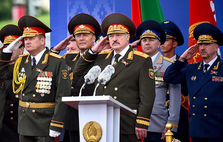 Belarusian President Alexander Lukashenko salutes during a military parade in Minsk, Belarus, on July 3, 2018. Journalist Dzmitry Halko was scheduled to go on trial July 10 in Minsk. (Sergei Gapon/Pool via Reuters)