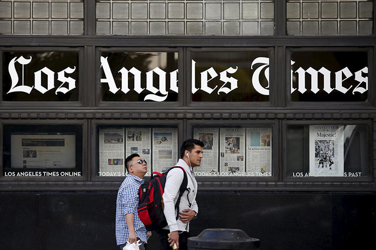 People walk past the building of the Los Angeles Times in Los Angeles, California, on April 27, 2016. (Reuters/Lucy Nicholson)