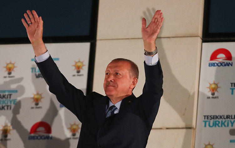 Turkish President Recep Tayyip Erdogan greets supporters in Ankara, Turkey, on June 25, 2018. A Turkish court handed heavy sentences to six journalists on July 6. (Reuters/Umit Bektas)