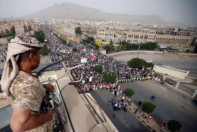 A Houthi fighter secures a rally in Sanaa, Yemen, on June 29, 2018. The Houthis have detained at least three more journalists since late June. (Reuters/Mohamed al-Sayaghi)
