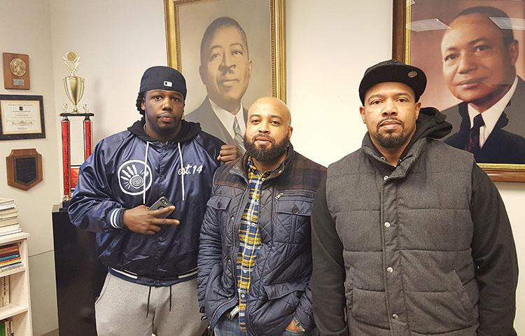 Zack Stoner, left, pictured with two members of Good Brothers, a community group he was part of. Stoner was shot dead in Chicago in May. (Charles Preston)