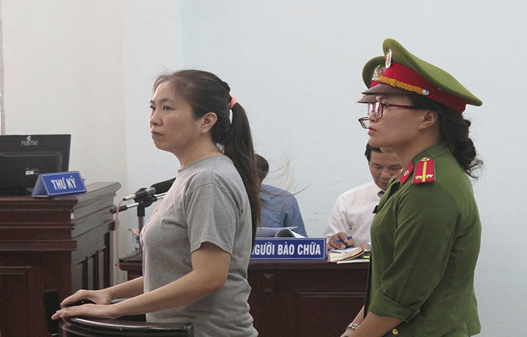 Prominent blogger Nguyen Ngoc Nhu Quynh, left, stands trial in Vietnam, on June 29, 2017. She was convicted on charges of distributing propoganda against the state, according to reports. (Vietnam News Agency/AP)