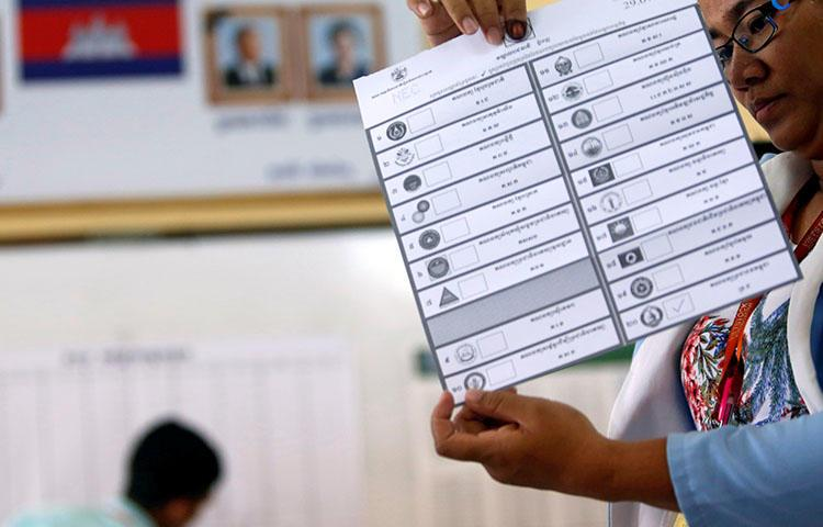 An official on July 29 counts ballots at a polling station in Phom Penh after polls have closed in Cambodia's general election. Cambodia's government blocked news websites ahead of the national election, according to reports. (Reuters/Samrang Pring)