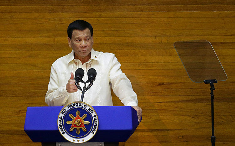 Philippine President Rodrigo Duterte delivers his State of the Nation address on July 23, 2018. A Filipino radio reporter was shot multiple times and died from his injuries on July 20 in the town of Daraga, in the country's central Albay province, according to reports. (Reuters/Czar Dancel)