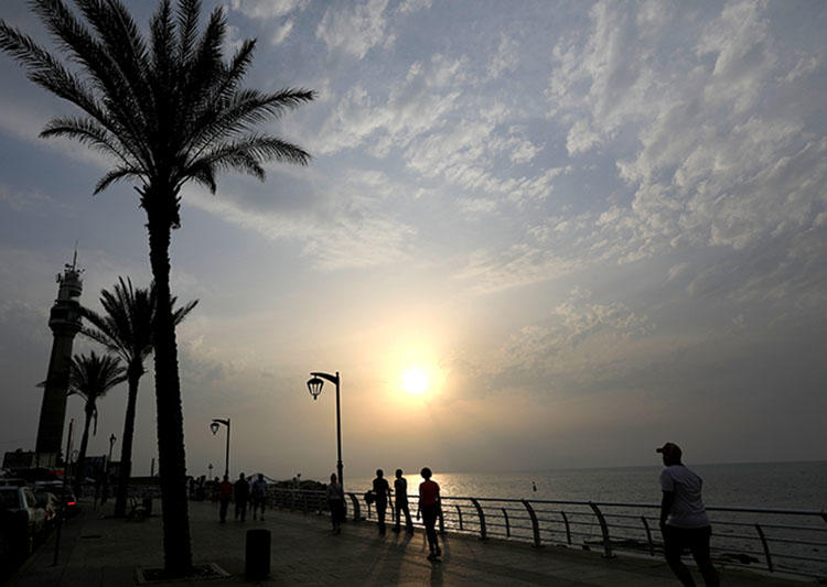 Sunset at the seaside in Beirut, Lebanon in May 2018. Beirut's Publication Court on July 5, 2018, convicted and fined five Lebanese journalists for offenses including criminal defamation and spreading false news, according to reports. (Reuters/ Jamal Saidi)