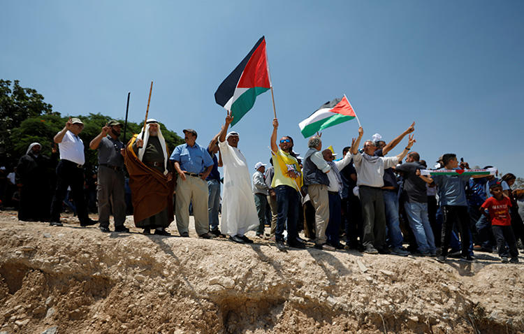 Palestinians protest against Israel's plans to demolish the Bedouin village of Khan al-Ahmar, in the occupied West Bank, on July 13, 2018. Israeli forces arrested and detained a Palestine TV reporter in the West Bank on August 15. (Reuters/Mohamad Torokman)