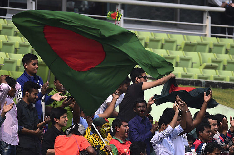 The Bangladesh flag is waved during a cricket match in Dhaka in early 2018. At least four journalists were attacked in Bangladesh while covering local elections in July. (AFP/Munir Uz Zaman)