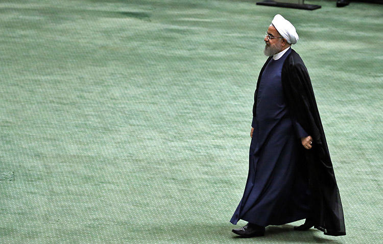 President Hassan Rouhani arrives at the Iranian parliament in Tehran on August 28. The country's courts recently ordered at least seven journalists to be jailed for lengthy sentences and to be flogged for their coverage of a religious protest. (AFP/Atta Kenare)