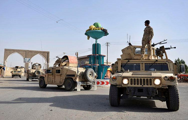 Afghan security personnel patrol in Ghazni city. Fighting between the Taliban and Afghan forces in and around Ghazni has left at least 20 civilians dead since August 10, the AP reported. (AP/Mohammad Anwar Danishyar)