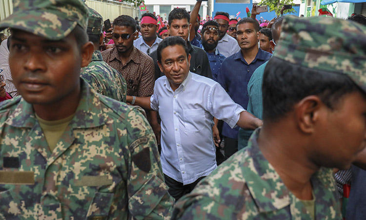 President Yameen, center, surrounded by his body guards in the capital, Malé, in February 2018. The president was criticized today for comments he made about missing Maldives journalist Rilwan. (AP/Mohamed Sharuhaan/File)