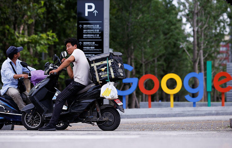 Google's logo is seen outside its office in Beijing. If the company were to launch a censored news app in China, it would send a message to other companies and other countries that trading press freedom principles for access to lucrative markets is acceptable. (Reuters/Thomas Peter)