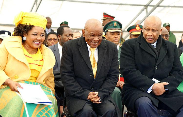 Lesotho Prime Minister Thomas Thabane, center, First Lady Maesaea Thabane, and King Letsie III are pictured during Thabane's inauguration on June 16, 2017 in Maseru. MoAfrika FM has reported critically on the prime minister and his wife. (Samson Motikoe/AFP)