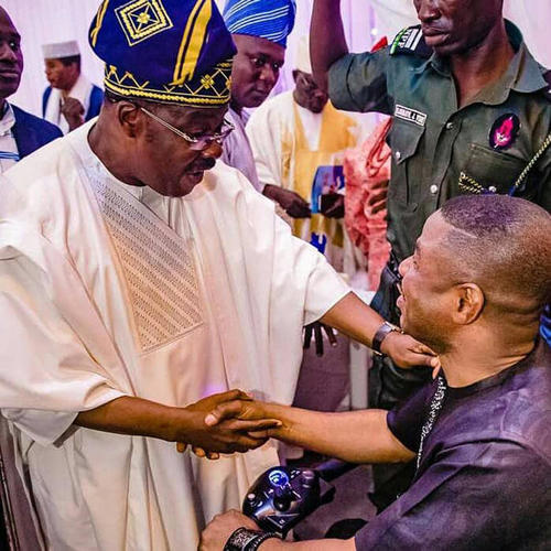 Nigerian musician and Fresh FM owner Yinka Ayefele (right) and Abiola Ajimobi, governor of Oyo state (left), greet each other on August 26, 2018, at an event for the 90th birthday of Oba Saliu Adetunji, The Olubadan (Lord of Ibadan). (Tolani Alli)