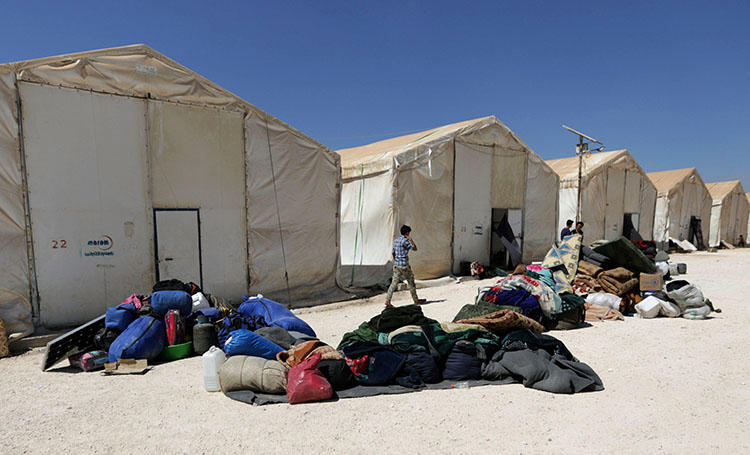 People internally displaced from Deraa province at a temporary camp in the Aleppo province in Syria on July 23, 2018. Civilians including at least 60 journalists fled the southern provinces of Daraa and Quneitra for northern Syria to escape advancing government-aligned forces. (Reuters/Khalil Ashawi)