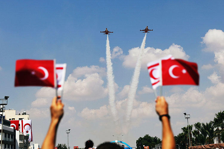 Turkish aircraft fly over a parade in the Turkish Cypriot northern part of the divided city of Nicosia, Cyprus on July 20, 2018. The parade marked the 1974 Turkish invasion of Cyprus. (Reuters/Yiannis Kourtoglou)