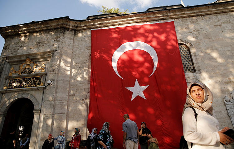 The Turkish flag hangs outside the Eyup Sultan mosque in Istanbul, Turkey on August 20, 2018. (Reuters/Murad Sezer)