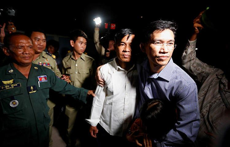 Uon Chhin, left, and Yeang Sothearin, former journalists for Radio Free Asia, leave prison in Cambodia after being freed on bail. Both still face espionage charges. (Reuters/Samrang Pring)