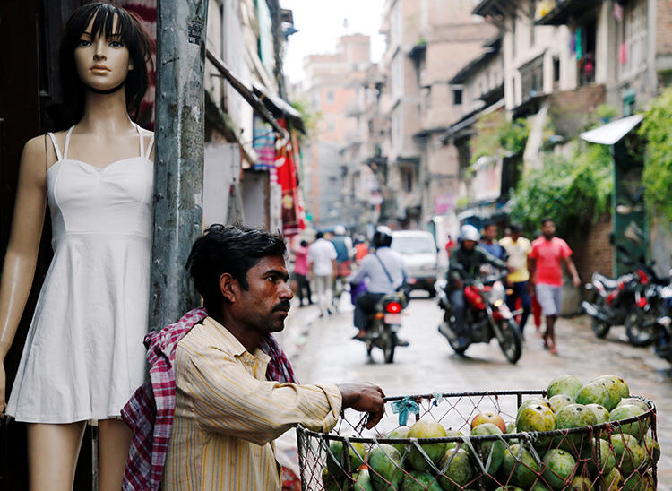 A street vendor waits for customers in Kathmandu, Nepal, on July 18, 2018. A new criminal code came into effect on August 17 in Nepal that threatened press freedom. (Reuters/Navesh Chitrakar)