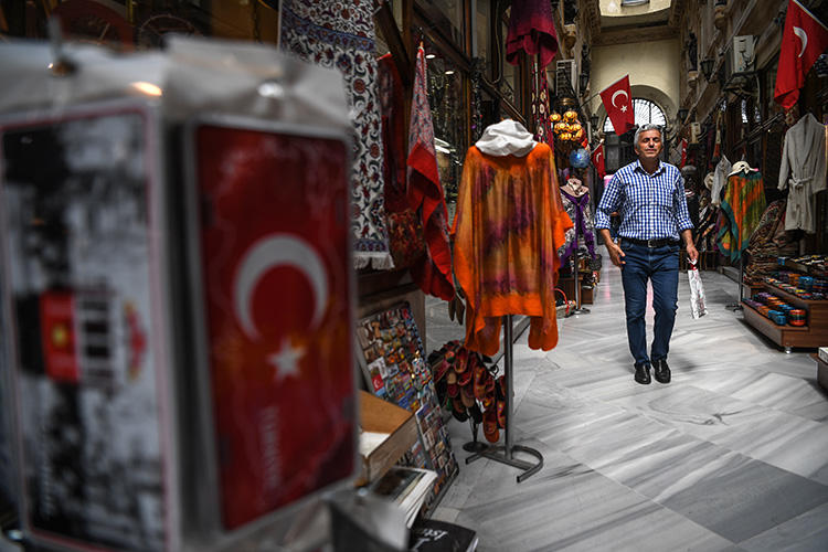 A man shops at the gallery on August 16, 2018 near the Istiklal avenue, at Beyoglu district, in Istanbul. (AFP/Ozan Kose)