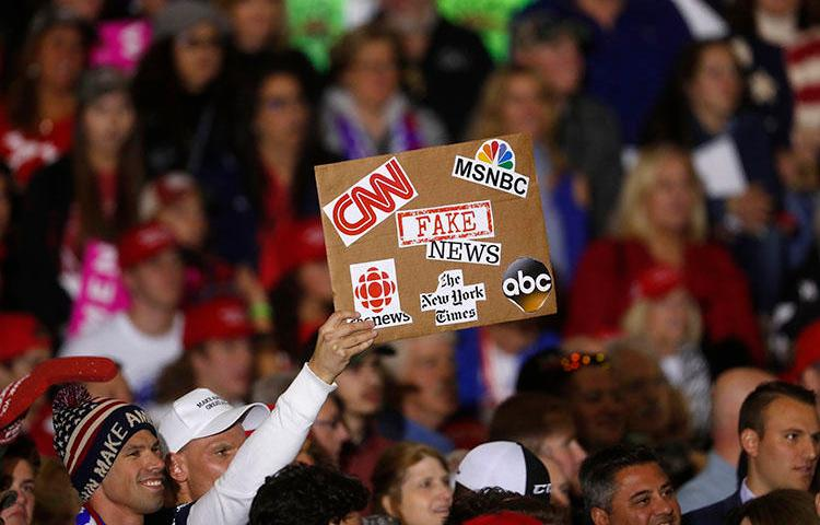 An audience member protests the news media during a President Donald Trump campaign rally in Washington Township, Michigan, on April 28, 2018. (AP/Paul Sancya)