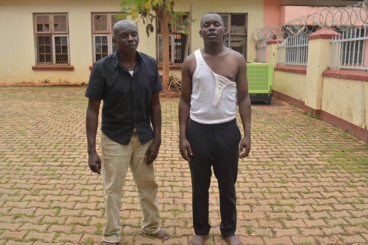 Journalists Herbert Zziwa, right, and Ronald Muwanga are pictured shortly after being released from Gulu Central Police station. (Daily Monitor/Julius Ocungi)