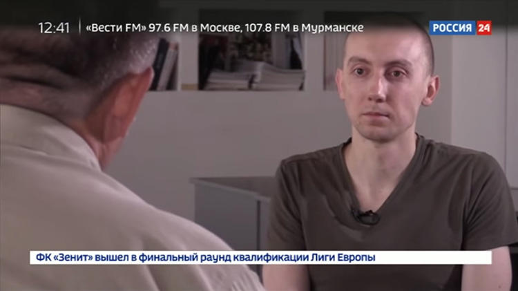 A screen shot taken on August 22, 2018, from the YouTube channel of Russian state-run TV channel Rossiya 24, of an August 17 broadcast of a false confession by Stanislav Aseyev, a Ukrainian reporter held for more than a year by Russia-backed separatists in Donetsk, in eastern Ukraine. (YouTube/Rossiya 24)
