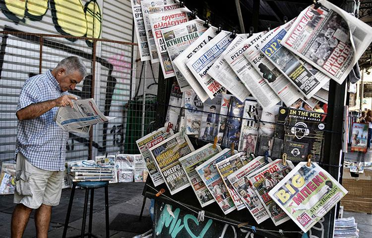 A newspaper stand in Athens, in July 2017. Police detained three journalists at the daily paper Fileleftheros, after a politician filed a defamation complaint. (AFP/Louisa Gouliamaki)